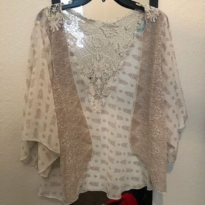 Super cute off white with lace back cover!